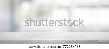 White stone marble table top and blurred abstract background from interior building banner background - can used for display or montage your products. Royalty-Free Stock Photo #772286263