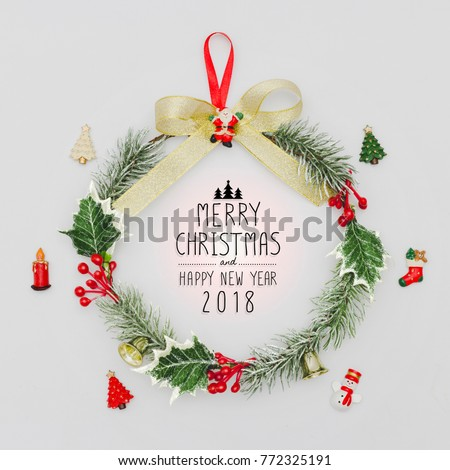 Christmas wreath and Happy New Year 2018 decorative ornament on white background.Gifts and congratulations holidays concept. #772325191
