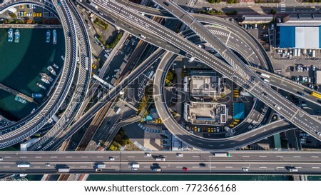Top view over the highway, expressway and motorway architecture, Aerial view overhead infrastructure interchange transport of Osaka City, Osaka, Kansai, Japan. Royalty-Free Stock Photo #772366168