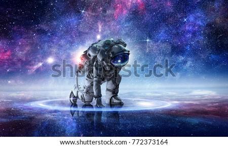 Astronaut starting to run. Mixed media Royalty-Free Stock Photo #772373164