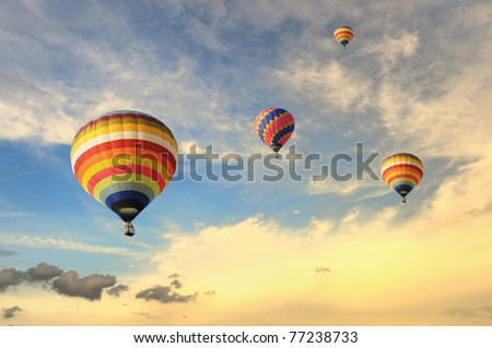 Colorful balloons rising up during sunset #77238733