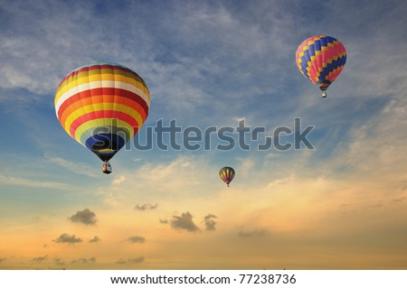 Colorful balloons rising up during sunset #77238736