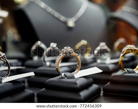 Jewelry diamond rings and necklaces show in luxury retail store window display showcase #772456309