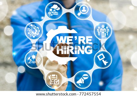Industrial worker using virtual touchscreen presses we're hiring gear button. Were hiring manufacturing. Join Our Team Industry concept. #772457554