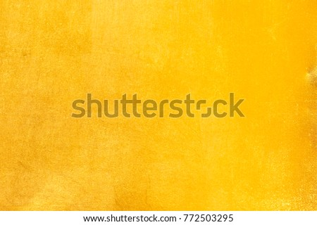Shiny yellow leaf gold foil texture background Royalty-Free Stock Photo #772503295