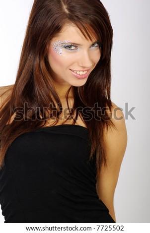 portrait of a beautiful girl wearing black shirt over grey background, fashion shot. beautiful make-up #7725502