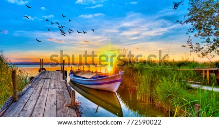 sunset of colors at the Lake Royalty-Free Stock Photo #772590022