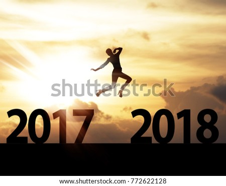 Men jump over silhouette Happy New Year 2018 #772622128