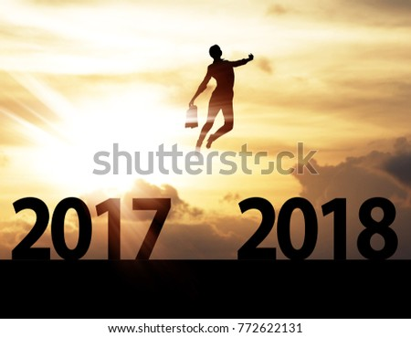 Men jump over silhouette Happy New Year 2018 #772622131