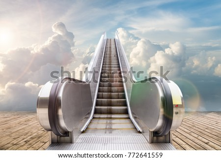 outdoor escalator to the sky , abstract background of rising way to heaven or  success Royalty-Free Stock Photo #772641559