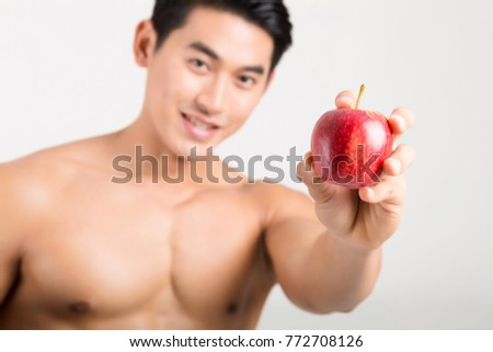 Sportsman Bites Green Apple After Training. Fitness and healthy lifestyle concept. Studio shot on white background. #772708126