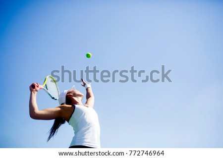 Beautiful female tennis player serving #772746964