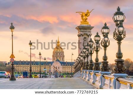 The Alexander III Bridge across Seine river in Paris, France at sunrise