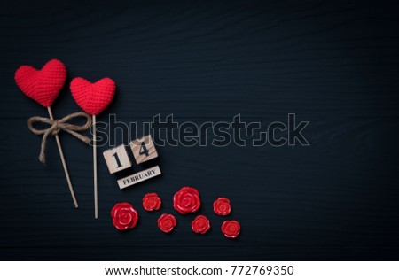 February 14th wooden calendar on wooden black background,valentines day card concept top view with copy space.  #772769350