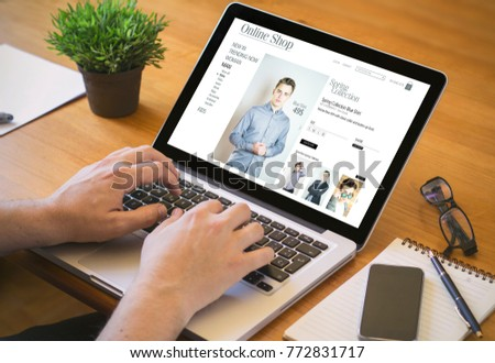 shopping online concept. Close-up top view of a online shop on laptop. all screen graphics are made up. #772831717