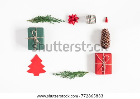 Christmas composition. Christmas gifts, pine branches, toys on white background. Flat lay, top view #772865833