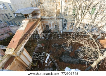 Mystical interior of abandoned of mansion of the Soviet period of USSR. Old abandoned ruined outdoor summer theater, movie theater. Ruins Ancient historical building, destroyed by vandals #772901746