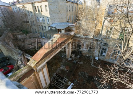 Mystical interior of abandoned of mansion of the Soviet period of USSR. Old abandoned ruined outdoor summer theater, movie theater. Ruins Ancient historical building, destroyed by vandals #772901773