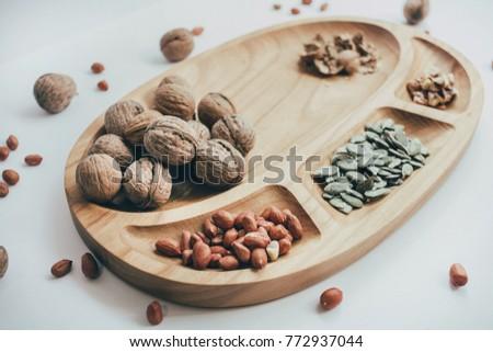 Nuts and honey photoset. Honey, walnut, cinnamon, sawed wood. Healthy food, health, eco products #772937044