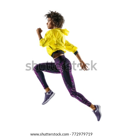 African girl runner in silhouette on white background. Dynamic movement. Side view #772979719