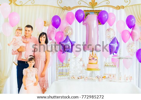 Happy family celebrates the birthday of the child in a beautiful holiday atmosphere #772985272