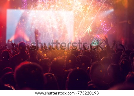 Colorful fireworks and crowd celebrating the New Year #773220193