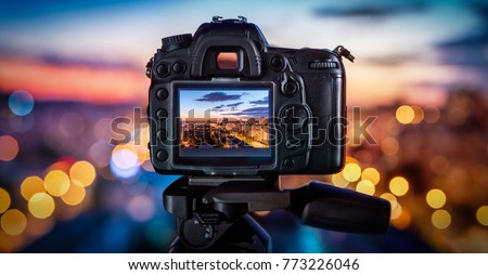 The camera on the background blurry city lights