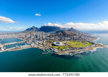 Aerial view of Cape Town, South Africa on a sunny afternoon. Photo taken from a helicopter during air tour of Cape Town Royalty-Free Stock Photo #773245780