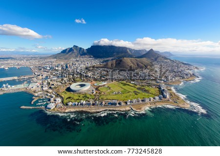 Aerial view of Cape Town, South Africa on a sunny afternoon. Photo taken from a helicopter during air tour of Cape Town Royalty-Free Stock Photo #773245828