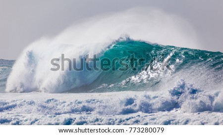 Powerful and dangerous, blue and aqua wave breaking near beach on Hawaii's Banzai Pipeline, North Shore of Oahu. Royalty-Free Stock Photo #773280079