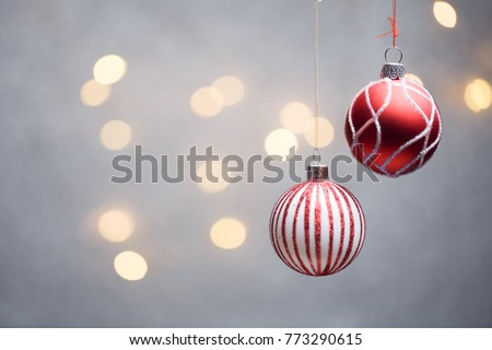 Photo of Christmas red balls on gray background with hot lights. #773290615