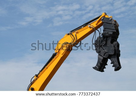 A Demolition Pulveriser on an Excavator Hydraulic Arm. Royalty-Free Stock Photo #773372437