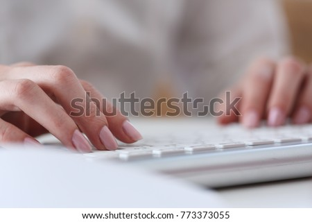 Female hands typing on silver keyboard using computer pc at workplace closeup. White collar job digital shopping office lifestyle search success enter login password and credentials concept #773373055