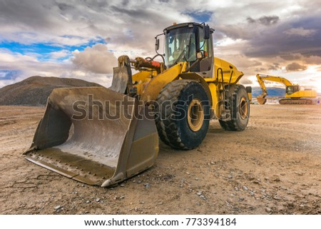 Excavator on a road construction site #773394184