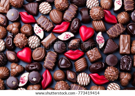 Assortment of fine chocolate candies, white, dark and milk chocolate. Sweets background. Copy space. Top view. #773419414