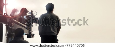 Behind the scenes of video shooting production crew team and professional camera equipment in studio.  Royalty-Free Stock Photo #773440705