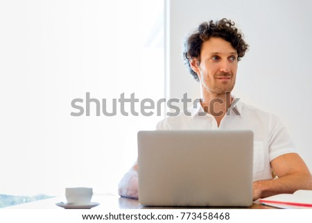 Man working on laptop at home #773458468