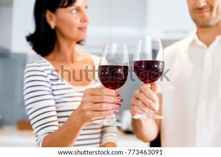 Portrait of a couple having a glass of red wine #773463091