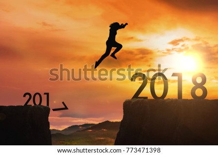 The woman jumping from 2017 cliff to 2018 cliff on sunrise time : meaning to going to year 2018 #773471398
