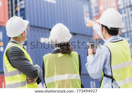 Back view of businessman with staff in logistic, export, import industry checking shipping cargo container freight. #773494927