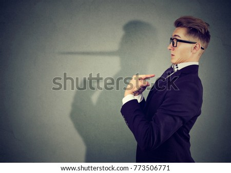 Side view of elegant man looking surprised when being caught on lie.  Royalty-Free Stock Photo #773506771