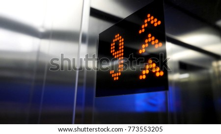 In elevator of modern business center on electronic LCD display. Interior of the elevator inside. View of the panel with the number and steel silver lining. monitor show number floor in elevator