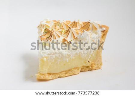 Slice of Lemon Pie isolated on white background