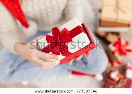 Teenage girl with Christmas presents #773587546