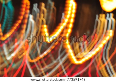 Beautiful blur and bokeh images. christmas light night,abstract circular bokeh background.bokeh lights and car lights illuminate the streets. #773591749