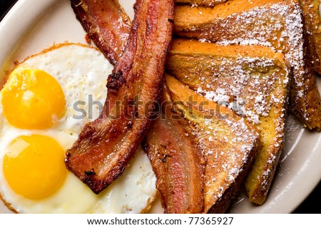 a Plate of French Toast, Eggs and Bacon for Breakfast #77365927