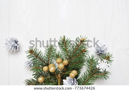 Mockup Christmas tree branch flatlay on a white wooden background, with place for your text #773674426