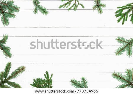 Christmas composition. Frame made of fir branches on white wooden background. Christmas, winter, concept of the New Year. Flat lay, top view, copy space #773734966