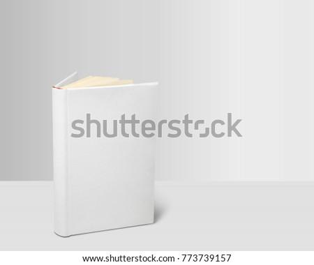 Whte book on white desk Royalty-Free Stock Photo #773739157