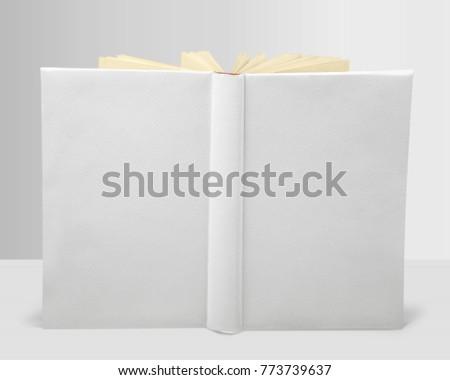 Whte book on white desk Royalty-Free Stock Photo #773739637